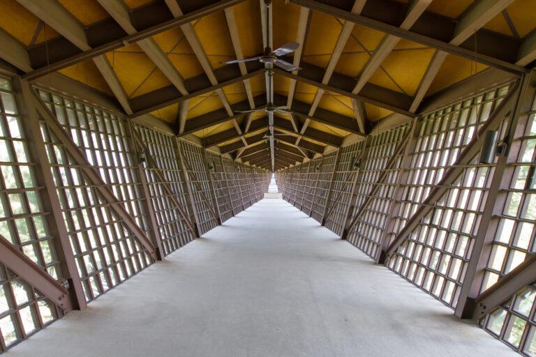 Bridge walkway inside with ceiling fans